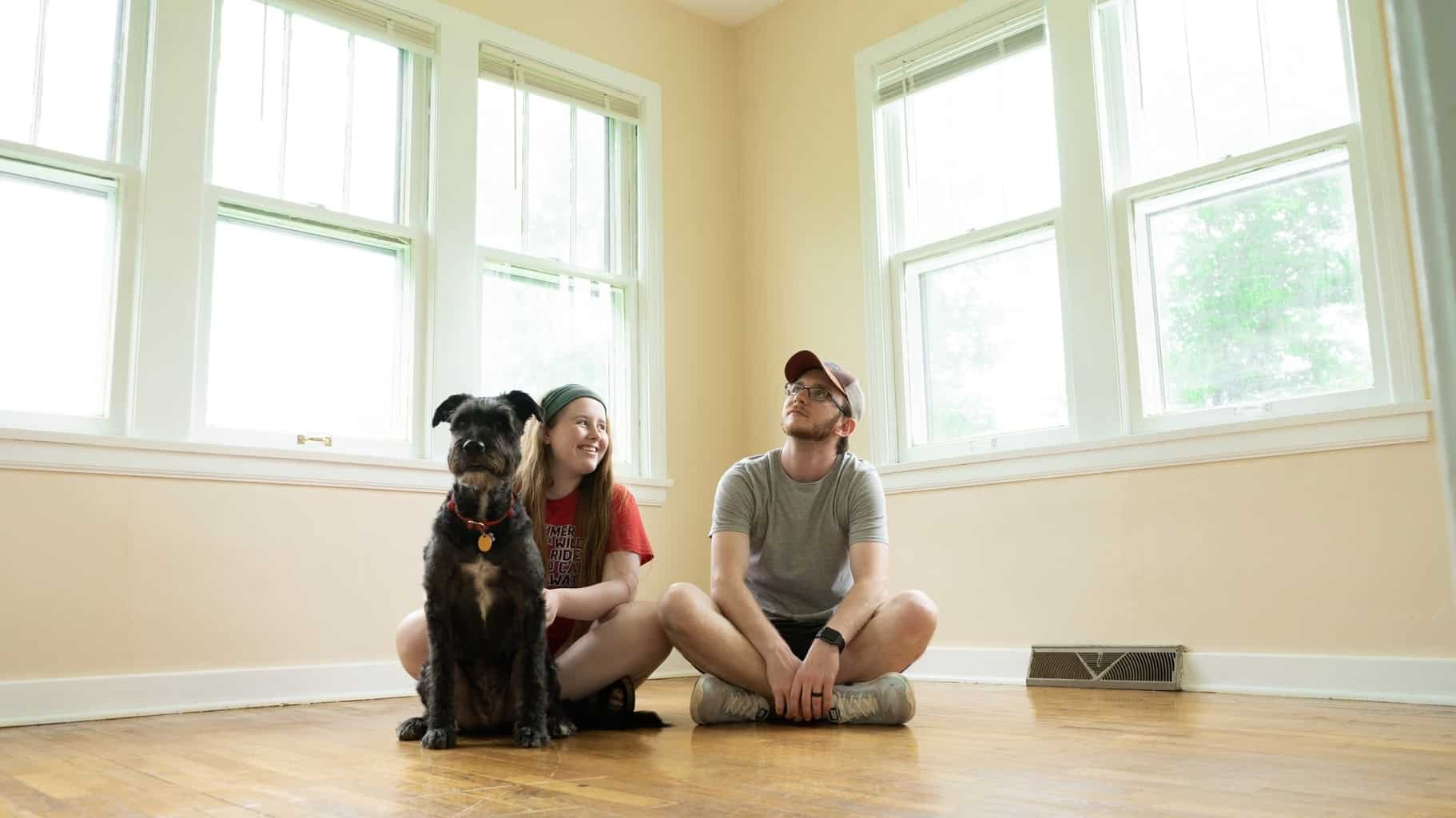 Couple sat on the floor in their new home