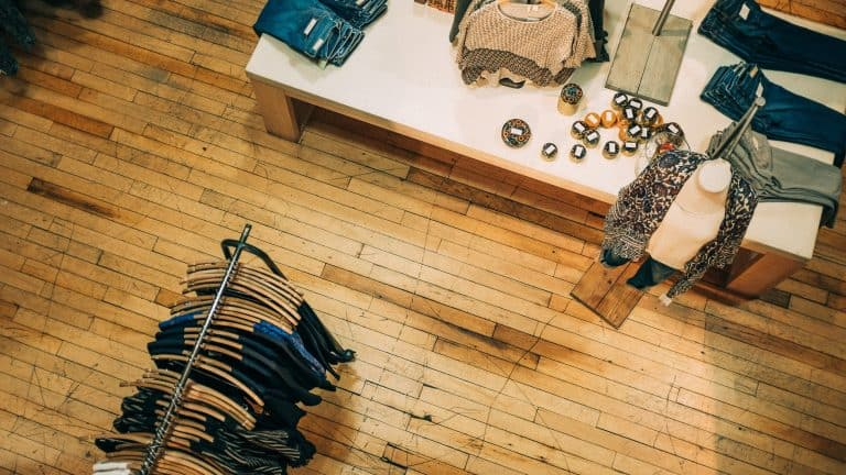 Rustic wooden flooring in a retail clothing store